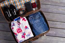Suitcase full of neatly packed clothing